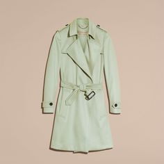 A softly structured trench coat in Italian-woven cashmere. The classic style is…