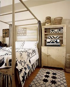 Cozy Prim Bedroom...love the quilts & rug.