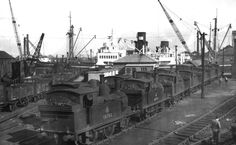 A superb view of Alexandra Docks depot which consisted of just two tracks with pits. On this occasion in 1950 the shed was occupied by 0-...