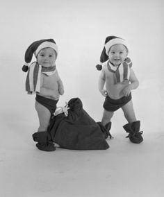 Baby twins dressed up as holiday elves