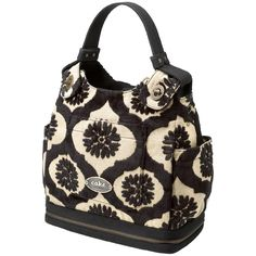 This is a diaper bag???!!! I hope this still have this when I'm ready for kids. Or maybe I should just buy it now and hold onto it lol. Can be used like purse, messenger bag or backpack! Petunia Pickle Bottom Cake Society Satchel Black Forest Cake