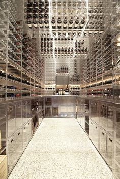 Wine cellar constructed of lucite and stainless steel to produce the appearance of endless reflection. Butler Armsden Architects