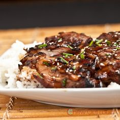 Grilled Teriyaki Chicken! Sounds really good but I think I would use cut up chicken breasts instead of the thighs, that's just me though!