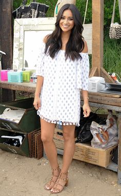 Shay Mitchell from The Best of the Red Carpet  The Pretty Little Liars star nails it in an off-the-shoulder dress with Valentino rock stud sandals at the Revolve Pop-Up launch in the Hamptons.