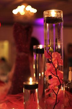 Looking for a unique centerpiece?  Try these beauties...orchids submerged in water with floating candles!  Venue: Grand Ballrooms  Decor: Weddings and Events Designed by Sylvain (W.E.D.S)