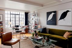 Stunning coffee table and worn leather chairs. Nate Berkus interiors.