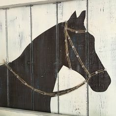 This multimedia horse painting, complete with nailed on jute bridle, is the perfect compliment to any horse lovers decor! Measures 18 x 18 x 2. The horse is painted on a wood slat canvas which has been painted and distressed. Then, a bridle is nailed into place with metal cut nails and strung with jute. Ready to hang with hanging wire already attached. Choose your own color scheme from the color chart shown above! SHOWN: brown horse on ivory background; black horse on ivory background, and…