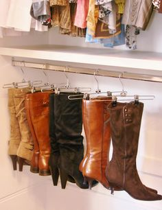 Boot organizing solution:  Install ultra low hanging rods in your closet.  Then use pant hangers (with rubber ends or thin foam for protection) to hang your boots from.