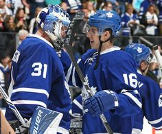 """TORONTO, ON - OCTOBER 15: Frederik Andersen <a class=""""pintag searchlink"""" data-query=""""%2331"""" data-type=""""hashtag"""" href=""""/search/?q=%2331&rs=hashtag"""" rel=""""nofollow"""" title=""""#31 search Pinterest"""">#31</a> and Mitchell Marner <a class=""""pintag searchlink"""" data-query=""""%2316"""" data-type=""""hashtag"""" href=""""/search/?q=%2316&rs=hashtag"""" rel=""""nofollow"""" title=""""#16 search Pinterest"""">#16</a> of the Toronto Maple Leafs celebrate a win against the Boston Bruins during an NHL game on October 15, 2016 at the Air Canada Centre in Toronto, Ontario, Canada. The Leafs defeated the Bruins 4-1. (Photo by Claus Andersen/Getty Images)"""
