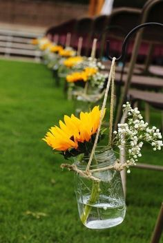 Mason jars with wedding flowers along the aisle are a big trend. These Sunflower… – Best Wedding Ceremony Ideas Wedding Ceremony Ideas, Outside Wedding Ceremonies, Wedding Themes, Fall Wedding, Rustic Wedding, Our Wedding, Dream Wedding, Trendy Wedding, Wedding Table
