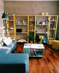 Ikea Ivar shelving system brighting up our living room. Bee hive boxes as coffee table. Little Lummi lamps around Hektar. Happy yellow - grey color scheme. Pots with cacti, succulents, pothos... Feels like home, it is home!
