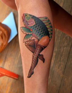 "When she was little, she would ask her father ""Will you draw me a mermaid?"" And her father, to get a rise out of her, would reverse the mermaid concept by giving a fish the lady legs.    Tattoo: Clay McCay    Savannah Ga.   at Anonymous Tattoo"