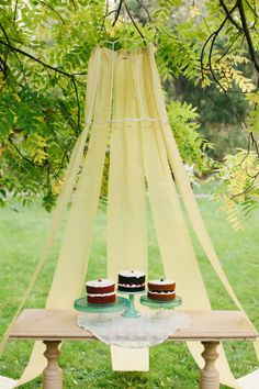Love the fabric draped over the lampshade form - perfect for an outdoor party----could use a hoop
