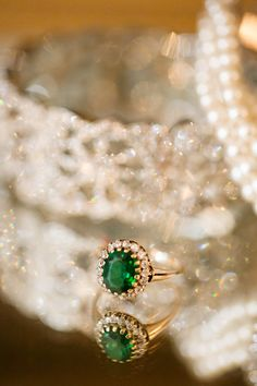 This exact setting with a clear, deep emerald. Photography: Heather Roth Fine Art Photography - www.heatherrothphotography.com  Read More: http://www.stylemepretty.com/2014/06/12/gorgeous-fall-wedding-in-st-louis/