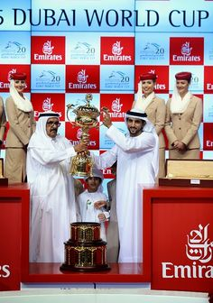 (L) Hamdan bin Rashid Al Maktoum, Deputy Ruler of Dubai and the Minister of Finance and Industry and (R) Hamdan bin Mohammed bin Rashid Al Maktoum, Crown Prince of Dubai celebrate winning the Dubai World Cup after Prince Bishop ridden by William Buick is victorious at the Meydan Racecourse on 28.03.2015 in Dubai, UAE.