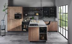 Harmonie in der Küche, sowohl optisch durch die Lehmfichte-Fronten in Verbindung mit schwarz-eloxierten Metall-Glastüren, den  Bordhaltern und dem dunklem Dekorglas, als auch funktionell bei der ergonomisch gestalteten Insel durch unterschiedliche Arbeitshöhen in der Spülen- und Kochzone. Kitchen Dining, Kitchen Island, Küchen Design, Sweet Home, Home Decor, Kitchens, Bedroom, Kitchen Black, Old Wood