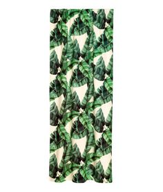 Dark green/leaf. Curtain panels in woven cotton fabric with a printed pattern. Wide cased heading. Hemming tape included. Pack contains two curtain panels.