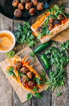 This meatball banh mi with pickled carrot and daikon, Sriracha mayo, cilantro, and jalapeno, is the most surprisingly delicious thing I've made in a while. If you're not already familiar, banh mi are a kind of Vietnamese sandwich,