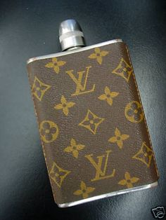 At bit pre-mad man but still rare vintage louis vuitton flask cool! Nothing wrong with a flask to get to get you through the day!