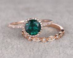 2pcs Emerald Engagement ring set, 14K&18K Rose/Yellow/White Gold Available. Every Jewelry in my store needs making to order.If you have the stone,you can ask us custom make this setting! [Item details] Engagement Ring: Solid 14K White Gold(Can be made in white/yellow/rose gold) Bottom Band Width approx 1.4mm Size 5#(Ring can be resized) 7mm Cushion Cut 1.3ctw VS Lab-Treated Emerald(Heating,diffusion) 0.14ctw Round Cut SI-H Natural Conflict Free Diamonds. Prong,Pave S...