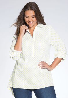 """Add a touch of classy comfort to your wardrobe. Our plus size popover shirt in fine stretch cotton fabric has great quality and a price to match. Also, it's so easy to wear–just throw it on and go!  relaxed fit with just a touch of stretch 30"""" length reaches the upper thighs shirt collar with hidden half button placket long sleeves with button cuff curved high/low hemline princess seams for a flattering fit soft, washable cotton/spandex imported  Women's plus size popover shirt in sizes..."""