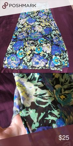 Sheer Floral Maxi Skirt Excellent condition, worn once. Has built in black stretchy shorts and 2 side slits. Elastic waist with zipper. Mimi Chica Skirts Maxi