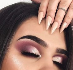 Pink soft cut crease with white shadows and bold brows, love this look for prom.
