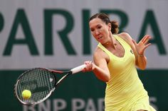 Braids can also be perfunctory and sleek. Witness Jelena Jankovic's neat way to hold a slick side part.