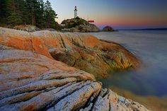 A summer sunset at Point Atkinson lighthouse in Lighthouse Park Vancouver BC on the way up to Whistler Places Around The World, Around The Worlds, All About Canada, Vancouver Bc Canada, Ocean Canvas, Summer Sunset, Whistler, Landscape Photography, Lighthouses