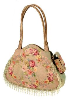 Michal Negrin love this purse and it even has a place for the phone.