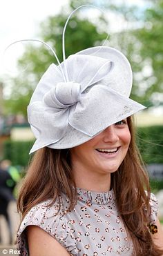 Stylish: A racegoer is elegant in a grey cocktail hat and chic dove grey patterned dress
