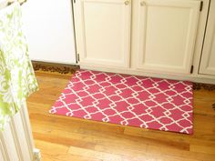 using vinyl flooring, white duck cloth, create your own design, paint it, urethane it and it's perfect... you choose the perfect size, perfect colour(s), design!! This has now been added to my summer todo list, gonna try to make runners for my hallways to protect my bamboo floors from the dog and the kids!