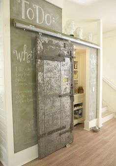 great pantry wall. Love the barn door material and the chalkboard wall. So creative