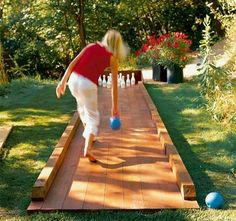 Just take laminate flooring, pop together and cheap boards on each side to make a yard bowling lane. I've seen ads on CL for leftover flooring in the free section.