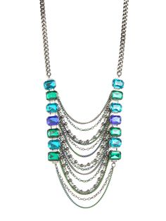 We love the high-drama factor behind this stunning statement necklace. Not only does it feature a set of oversized ocean-blue gems, but there's a dynamic cascade of colored chain links, too.