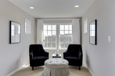 Tasteful elegant sitting area with tufted stool at the Dartmouth II at Sheridan Estates by Dan Ryan Builders. Home Style Ideas