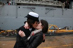 The Navy's traditional first homecoming kiss is shared by a lesbian couple, possibly (and most likely) for the first time ever. <3<3<3