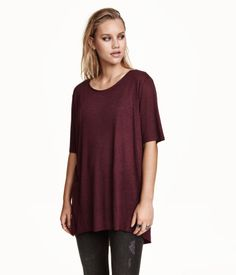 Long T-shirt in jersey with raw edges at neckline and hem. Slightly longer 92ae6d453e