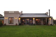 vista contrafrente: Casas de estilo rural por Parrado Arquitectura