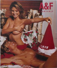 Heidi Klum and unidentified male model on cover of the Christmas issue of Abercrombie & Fitch Quarterly, 2002