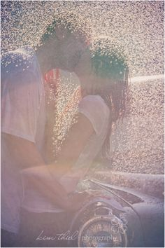 kissing in the water // rain - kim thiel photography