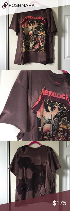 """Unisex fit -- Metallica distressed tee Size unisex large. Worn once. Distressed raw edge hem on sleeves and bottom area. Pristine condition. Length 27 inch --- width 25 inches. Last photo is me wearing it I'm 5'2 this is a great oversized fit.     🚩PLEASE READ: Price firm. This is my """"lowest"""" . I don't trade & no offsite transactions. Posh only. No Holds. 🚩 Boutique Shirts Tees - Short Sleeve"""