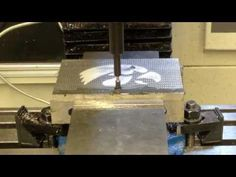 """Watch """"CNC Engine Turning, Jeweling, Damascening on Tormach PCNC 770"""" on YouTube He uses a vinyl sticker to mask the area that he doesn't want jeweled."""