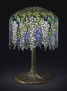 "** Tiffany Studios, New York, Favrile Leaded Glass and Patinated Bronze ""Wisteria"" Lamp."