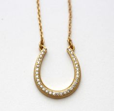 This is a gently used Kate Spade New York Wild Ones Pave Horseshoe Mini Pendant Necklace. This necklace is in like new condition, no visible sign of wear. 12K gold plated horseshoe necklace with pave crystals 12K gold plated metal Cubic zirconia Lobster clasp closure Style # WBRUG086 Retail Price $58 plus tax Measurements Length: 16.25-19.25in / 41-49cm Drop: 10.25in / 26cm Pendant length: 1in / 2.5cm Horseshoe Necklace, Gold Necklace, Pendant Necklace, Kate Spade Necklace, Equestrian Jewelry, Wild Ones, Mini Pendant, Retail Price, Lobster Clasp