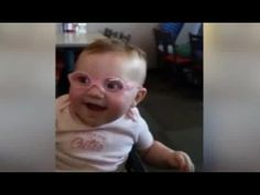 1335af92b188 Baby sees parents clearly for the first time with special glasses - and her  reaction is precious!
