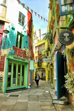 Hidden down an alley behind Covent Garden, London - Neal's Yard is a unique and colorful shopping area lined with 'slow food' and 'raw-centric' cafes
