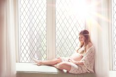 #Maternity photography , sitting next to the window with this beautiful sunlight coming in.