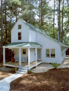 This 1,350 square foot house is nestled into a stand of 90' tall pine trees; only one was removed for construction. High, open spaces and careful material selection make the most of a modest floor plan and budget. Plywood doubles as sheathing and exterior finish material. Closely-spaced battens on the plywood correspond to foundation block modules and windows so that the simple forms are crisp and clear.