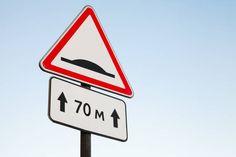 speed bump warning road sign